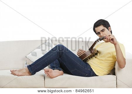 Man adjusting string of his mandolin