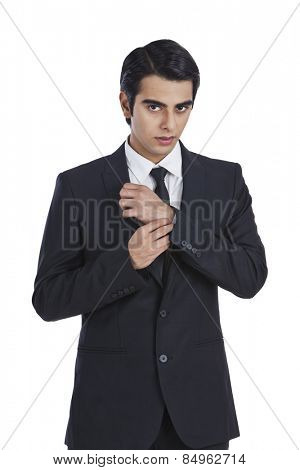 Portrait of a businessman getting dressed