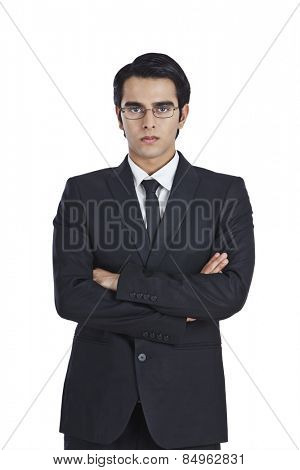 Portrait of a businessman standing with his arms crossed