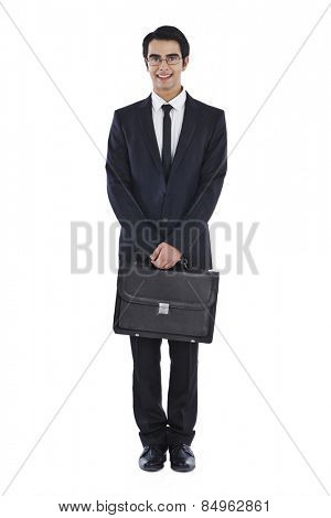 Portrait of a businessman holding a bag and smiling