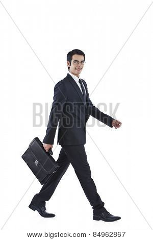 Businessman walking with holding a bag