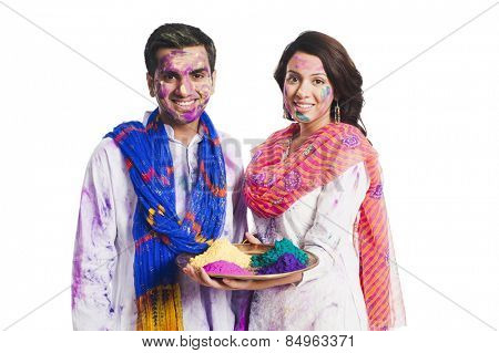 Couple celebrating Holi with Holi colors
