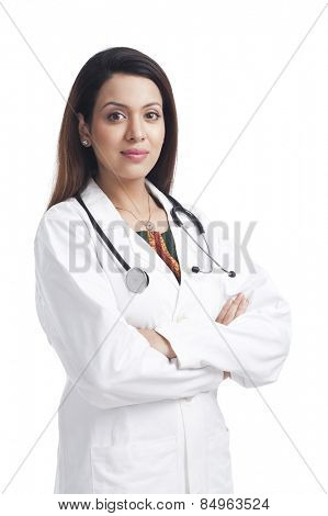 Female doctor standing with her arms crossed