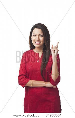 Portrait of a happy woman pointing