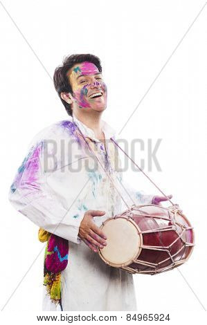 Man celebrating Holi with playing dholak