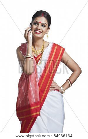 Traditional Bengali woman talking on cell phone