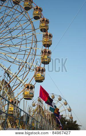 Low angle view of a ferris wheel at Pushkar Camel Fair, Pushkar, Ajmer, Rajasthan, India