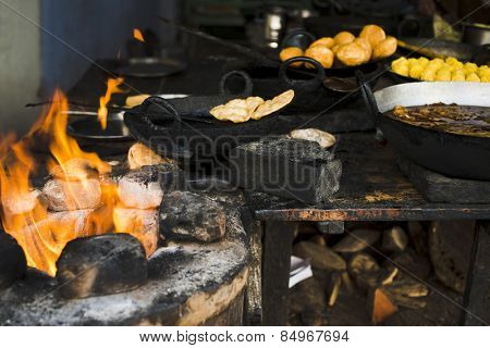 Traditional snacks and sweets being cooked at a store, Pushkar, Ajmer, Rajasthan, India