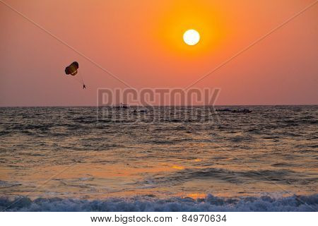 Silhouette of a person parasailing over the sea, Panjim, Goa, India