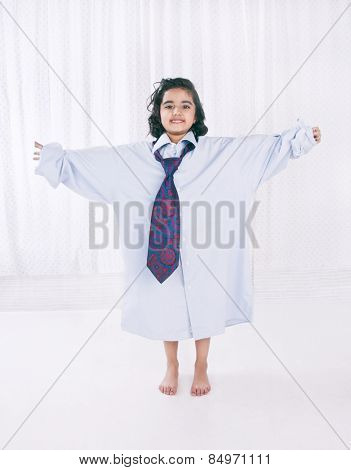 Portrait of a girl wearing oversize shirt with tie