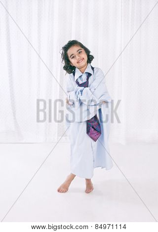 Portrait of a smiling girl wearing oversize shirt with tie