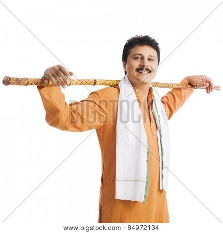 Portrait of a man with wooden staff on his shoulders