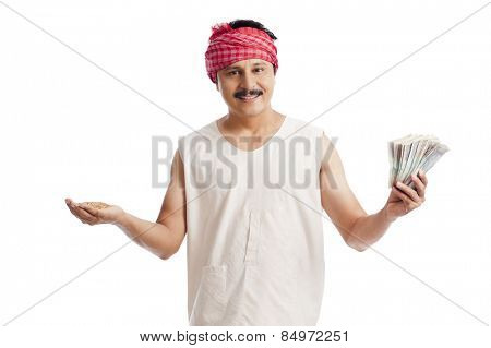 Portrait of a farmer holding money in one hand and wheat in another hand