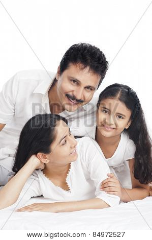 Portrait of a girl smiling with her parents