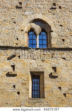Windows of a palace, Palazzo Dei Priori, Volterra, Province of Pisa, Tuscany, Italy