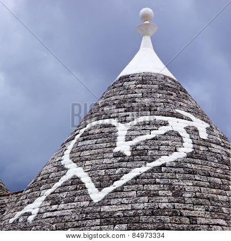 Low angle view of a heart shape painted on a trulli house, Alberobello, Bari, Puglia, Italy