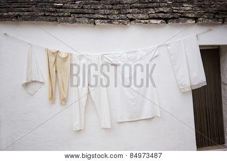 Clothes drying outside a trulli house, Alberobello, Bari, Puglia, Italy