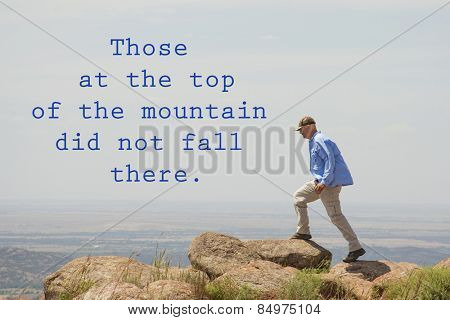 Those at the top of the mountain did not fall there - quote by unknown author, with an image of a man walking on top of a mountain