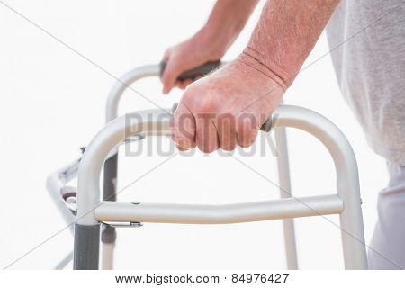 Senior man walking with zimmer frame