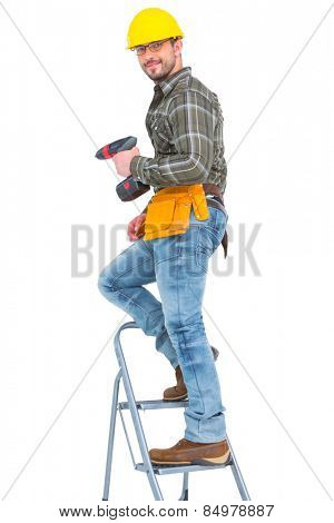 Repairman with drill machine climbing ladder on white background