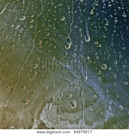 Water Drops over Marble texture background