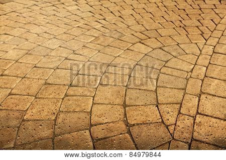 Pavement paved with cobblestone with water drops in grunge