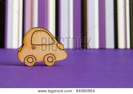 Wooden Car Icon On Purple Striped Background