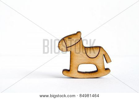 Wooden Icon Of Children's Rocking Horse On White Background