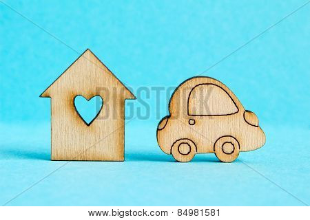 Wooden House With Hole In The Form Of Heart With Car Icon On Blue Background