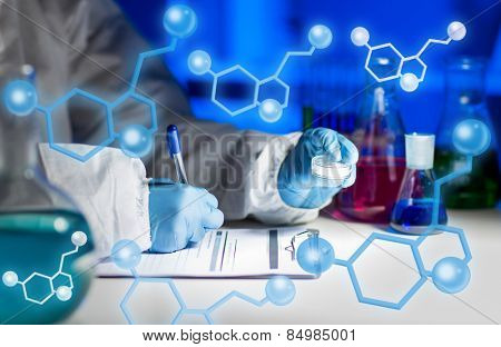 science, chemistry, medicine and people concept - close up of young scientist with chemical sample taking notes on clipboard and making test or research in laboratory over molecular structure