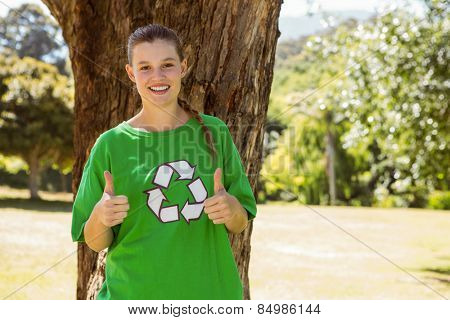 Environmental activist showing thumbs up on a sunny day
