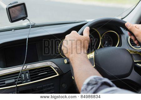Man using satellite navigation system in his car