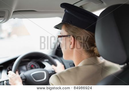 Chauffeur looking at the road in the car