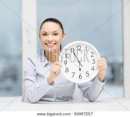 business, office, school and education concept - attractive businesswoman showing clock
