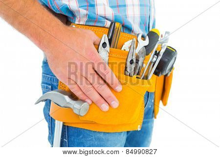Midsection of handyman wearing tool belt on white background