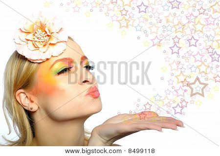 Concept Of Summer Woman With Creative Eye Make-up In Yellow And Green Tones Bloving Stars From Her H