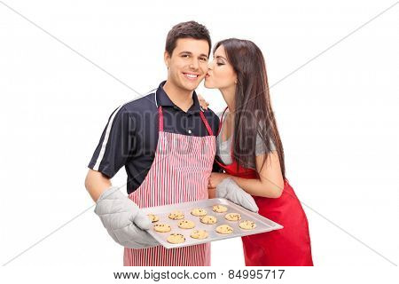 Young couple baking cookies together isolated on white background