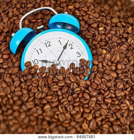 Alarm clock on coffee beans