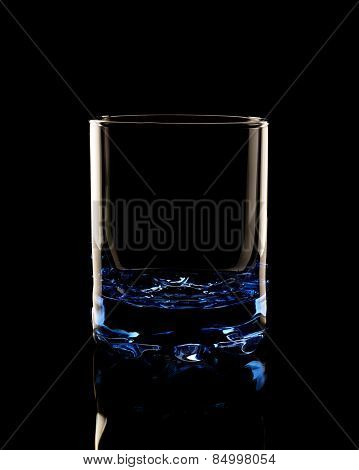 Old fashioned glass in the low-key lighting