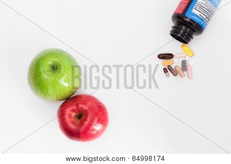 Two apples and pills