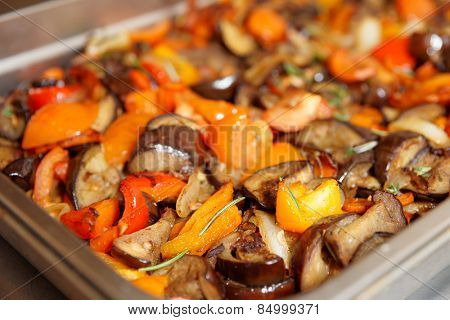 Vegetable ragout in steel container at commercial kitchen