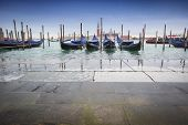 Постер, плакат: Gondolas Moored In Front Of Pavement
