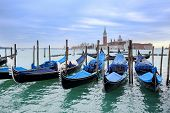 Постер, плакат: Gondolas Moored In Front Of San Giorgio Maggiore
