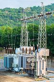 stock photo of transformer  - Transformer station and the high voltage electric pole - JPG