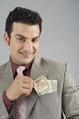 picture of indian currency  - Businessman with Indian five hundred rupee banknotes in his pocket - JPG