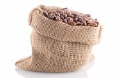 image of pinto bean  - Closeup of pinto beans bag on white background - JPG