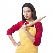 picture of salwar  - Portrait of a woman holding a rolling pin - JPG