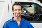 pic of shipping receiving  - Portrait of smiling man standing in front of delivery van - JPG