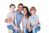 picture of lap  - Portrait of happy children sitting on parents laps over white background - JPG