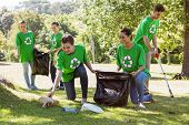 image of pick up  - Environmental activists picking up trash on a sunny day - JPG